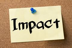 Impact - adhesive label pinned on bulletin board Stock Photos