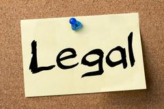 Legal - adhesive label pinned on bulletin board Stock Photos