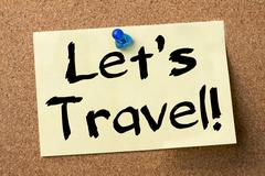 Lets travel! - adhesive label pinned on bulletin board Stock Photos