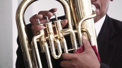 Artist playing baritone horn Stock Footage
