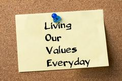 Living Our Values Everyday LOVE - adhesive label pinned on bulletin board Stock Photos
