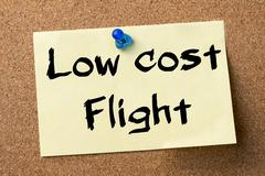 Low cost Flight - adhesive label pinned on bulletin board Stock Photos