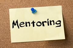 Mentoring - adhesive label pinned on bulletin board Stock Photos