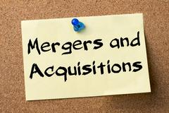Mergers and Acquisitions - adhesive label pinned on bulletin board Stock Photos