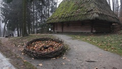 Authentic european wooden houses with thatched, straw roof, located in the Stock Footage