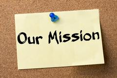 Our Mission - adhesive label pinned on bulletin board Stock Photos