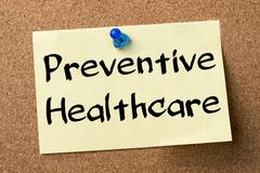 Preventive Healthcare - adhesive label pinned on bulletin board Stock Photos