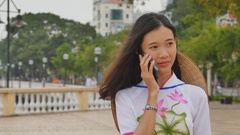 Vietnamese girl talking on the phone Stock Footage