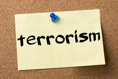 Terrorism - adhesive label pinned on bulletin board Stock Photos