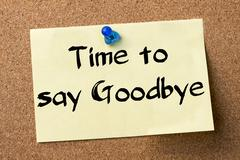 Time to say Goodbye - adhesive label pinned on bulletin board Stock Photos