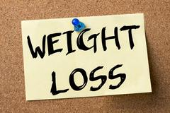 WEIGHT LOSS - adhesive label pinned on bulletin board Stock Photos