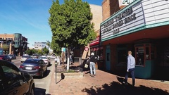 Pan From Movie Marquee To Skateboarders  Tempe Arizona Stock Footage