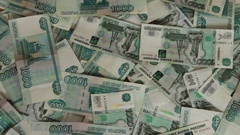 A lot of banknotes Russian rubles lying on the floor Stock Footage
