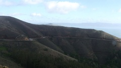 Timelapse of cars driving on the mountain road in marin headlands, near the.. Stock Footage