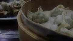 Steamed dumplings in a steamer Stock Footage