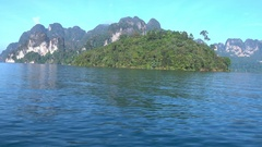 View from boat on island on Cheow Lan lake Stock Footage