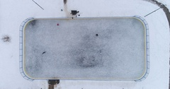 Ice hockey rink in the city park. Players shoot the puck. Aerial view. Stock Footage