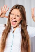 Angry young woman shout. Stock Photos