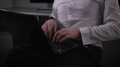 Close up of a young businessman working on laptop. IT specialist of company is Stock Footage