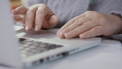 Close-up of female hands on the laptop keyboard Stock Footage