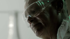Professional male engineer in protective transparent glasses tells about the Stock Footage