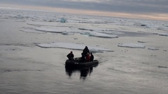 Rubber dinghy with divers on the background of icebergs, ice, in Arctic Ocean. Stock Footage