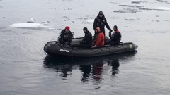 Dinghy with people on the background of icebergs, ice, in Arctic Ocean. Stock Footage