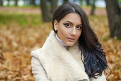 Facial portrait of a beautiful arab woman warmly clothed outdoor Stock Photos