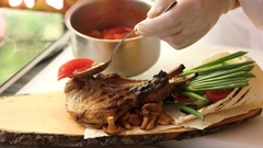 Grilled pork steak and vegetables. Stock Footage