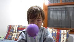 Boy with swollen eye plays with lamp light Stock Footage