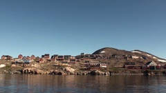 Small city in Greenland in the Arctic Ocean. Zoom out. Stock Footage
