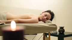 Young woman lies on a massage table - therapeutic manual therapy Stock Footage