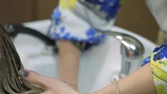 Hair care in the modern Spa. woman having hair washed by hairdresser in hair Stock Footage