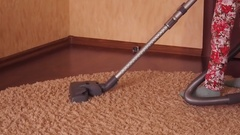 Child vacuuming the room. Stock Footage