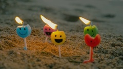 Burning candles with smiling faces Stock Footage