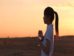 Young Japanese woman drinking while training on the beach at sunset, Chiba Stock Footage
