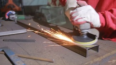 Metal grinding. Metal sawing. Electric wheel grinding process on steel structure Stock Footage