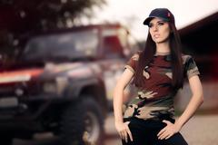 Female Driver in Army Outfit Next to an Off Road Car Stock Photos