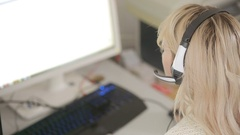 Close-up of business woman talking on headset in a call center Stock Footage
