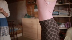 Designer takes measurements measuring tape dress before tailoring for girls Stock Footage