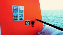 Sticker with instructions on tug deck. Life raft with manual inflatable for Stock Footage