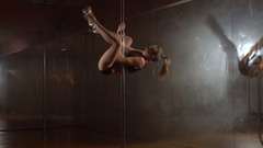 Young woman exercising pole dance fitness, upside down. Slow motion. Stock Footage