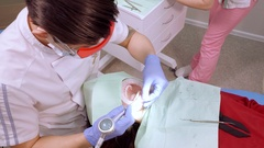 Procedure for cleaning the mouth and teeth. the use of modern equipment. caries Stock Footage
