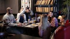 Restful teenage friends enjoying in the cafe Stock Footage