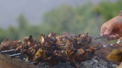 Slow Motion Hands Turn Over Kebabs Skewers in Grill Smoke Stock Footage