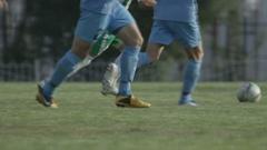 Two Football Teams Play Football on Green Stadium Field Stock Footage