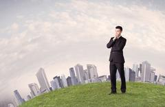 Man standing in front of city landscape Stock Photos