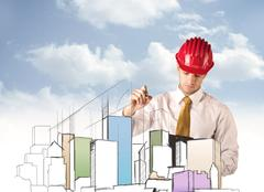 Construction worker planning a city sight Stock Photos