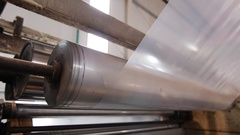 Plastic sheet curled on a roll at the factory Stock Footage