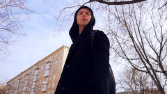 Male model in winter the city is in a big black coat . On the background of high Stock Footage